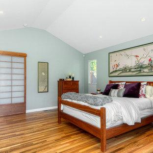 Bedroom - mid-sized master medium tone wood floor bedroom idea in San Francisco with green walls