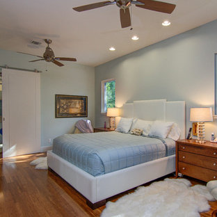 Design ideas for a large contemporary master bedroom in Tampa with blue walls and bamboo floors.