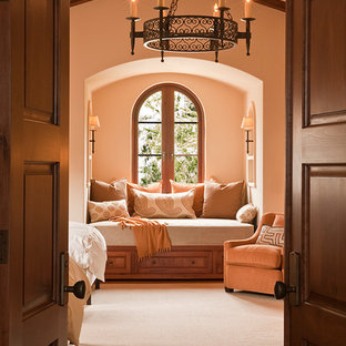Design ideas for a mediterranean guest bedroom in San Francisco with beige walls, medium hardwood floors and brown floor.