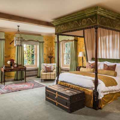 Inspiration for a large timeless master carpeted and green floor bedroom remodel in Sussex with yellow walls