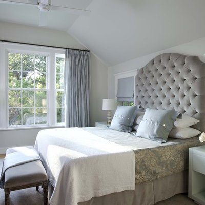 Example of a classic guest bedroom design in Austin with gray walls and no fireplace