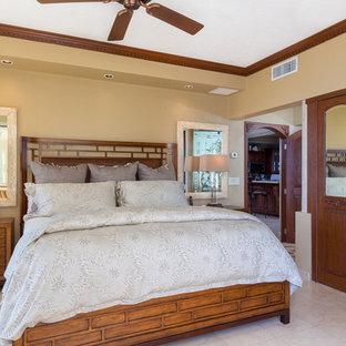 Coastal master limestone floor bedroom photo in Other with beige walls