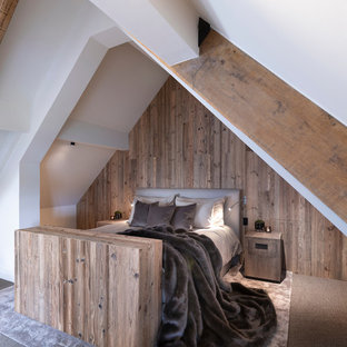 Design ideas for a large rustic guest bedroom in Cheshire with white walls, carpet, no fireplace and brown floors.