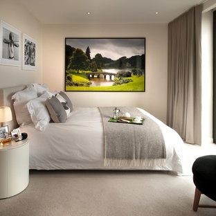 Mid-sized trendy master carpeted and beige floor bedroom photo in London with beige walls