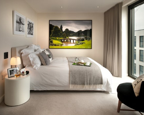 Mid Sized Trendy Master Carpeted And Beige Floor Bedroom Photo In London  With Beige Walls
