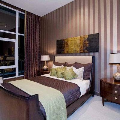 Mid-sized trendy master carpeted and beige floor bedroom photo in Portland with multicolored walls and no fireplace