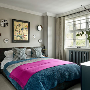 This is an example of a contemporary master bedroom in Surrey with grey walls, carpet and grey floors.