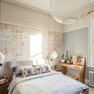 Design ideas for a bohemian bedroom in Manchester with blue walls, carpet and beige floors.