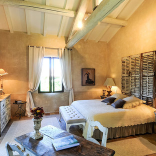 Design ideas for a mid-sized country guest bedroom with multi-coloured walls, limestone floors, a standard fireplace and multi-coloured floor.