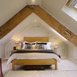 Photo of a farmhouse bedroom in Other with beige walls.