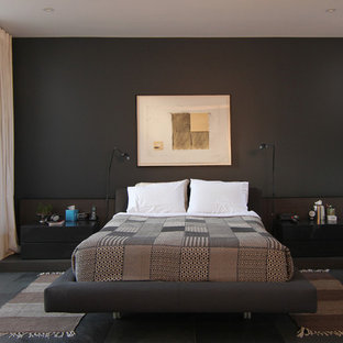 Inspiration for a contemporary master black floor bedroom remodel in Toronto with black walls and no fireplace