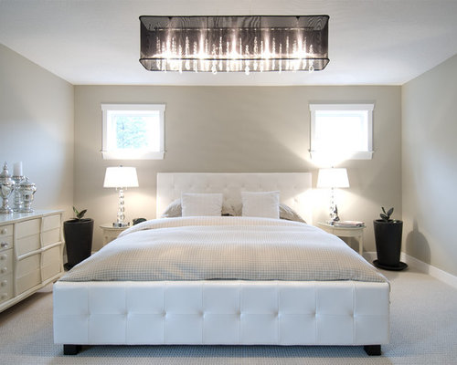 Example of a minimalist carpeted bedroom design in Vancouver with beige  walls