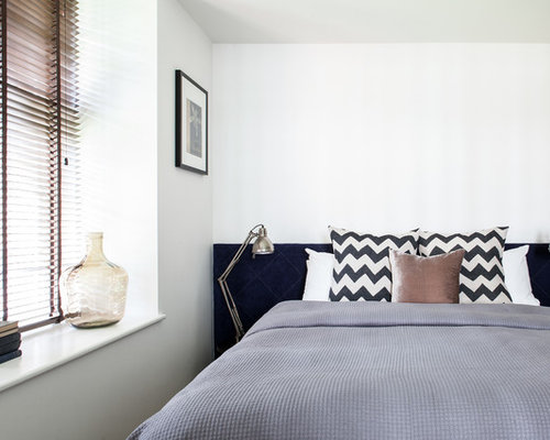 Design Ideas For A Contemporary Bedroom In London With White Walls.