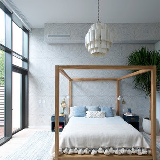 Bedroom - contemporary master light wood floor bedroom idea in New York with multicolored walls
