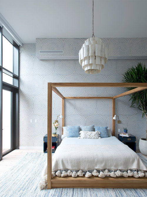 Contemporary master light wood floor bedroom idea in New York with  multicolored walls