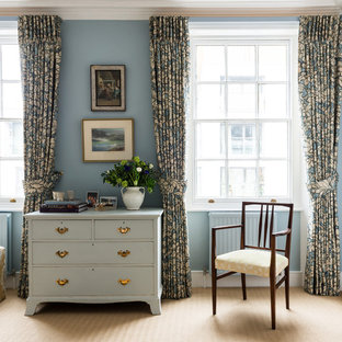 Example of a mid-sized transitional master carpeted bedroom design in London with blue walls