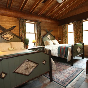 This is an example of a mid-sized country guest bedroom in Minneapolis with slate floors and no fireplace.