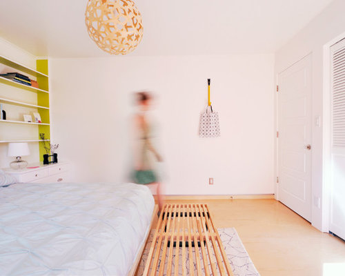 Example Of A Trendy Plywood Floor Bedroom Design In Salt Lake City With  White Walls