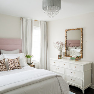 Inspiration for a mid-sized transitional guest dark wood floor and brown floor bedroom remodel in Detroit with beige walls