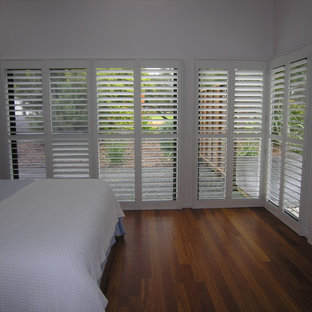Example of a minimalist bedroom design in Melbourne