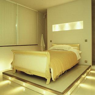 Пример оригинального дизайна: гостевая спальня среднего размера в стиле модернизм с белыми стенами, бетонным полом и белым полом