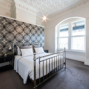 Expansive transitional master bedroom in Melbourne with black walls, carpet and grey floor.