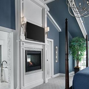 Ejemplo de dormitorio principal, clásico, grande, con paredes azules, moqueta, estufa de leña, marco de chimenea de baldosas y/o azulejos y suelo gris