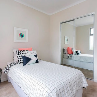 Small contemporary guest bedroom in Adelaide with beige walls, carpet and brown floor.