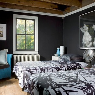 Inspiration for a small contemporary guest bedroom in Philadelphia with light hardwood flooring and black walls.