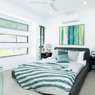 Inspiration for a contemporary guest bedroom in Geelong with white walls, carpet, no fireplace and beige floor.