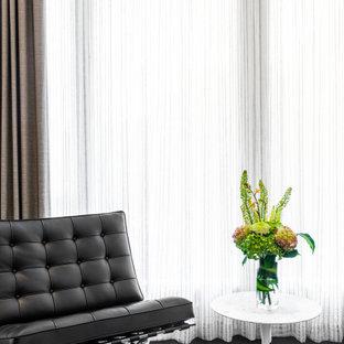 Ispirazione per una grande camera matrimoniale design con pareti bianche, parquet scuro, camino lineare Ribbon, cornice del camino in cemento e pavimento nero