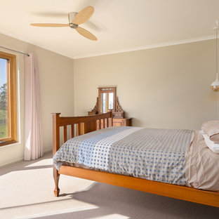 Inspiration for a large contemporary master bedroom in Other with carpet, beige walls and beige floor.