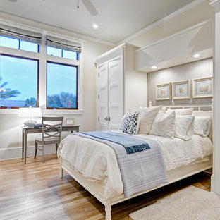 Beach style bedroom photo in Jacksonville with beige walls