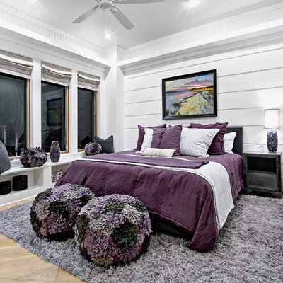 Inspiration for a coastal light wood floor bedroom remodel in Jacksonville with white walls and no fireplace