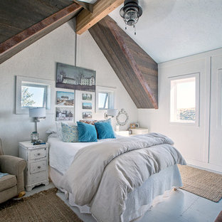 Photo of a mid-sized contemporary loft-style bedroom in Other with white walls, painted wood floors and blue floor.