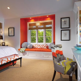 This is an example of a traditional bedroom in Orange County with orange walls and carpet.