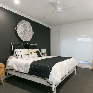 This is an example of a contemporary bedroom in Adelaide with white walls, carpet, no fireplace and grey floor.