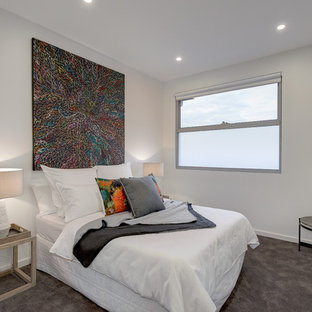 Photo of a contemporary bedroom in Melbourne with white walls, carpet and grey floor.