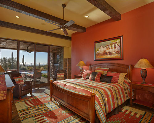 Example Of A Mid Sized Southwest Master Medium Tone Wood Floor Bedroom  Design In Phoenix