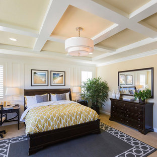 Inspiration for a mid-sized traditional master bedroom in Miami with yellow walls, carpet and beige floor.