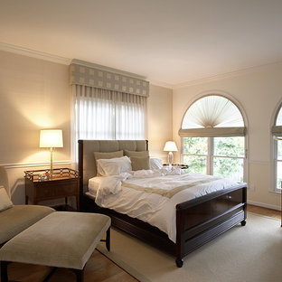 Inspiration for a timeless bedroom remodel in DC Metro with beige walls