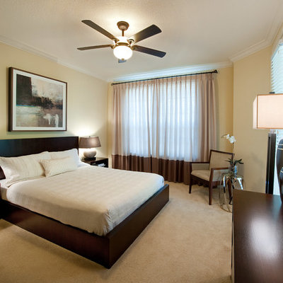 Bedroom - transitional carpeted bedroom idea in Tampa with beige walls