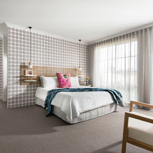 Photo of a mid-sized contemporary master bedroom in Perth with multi-coloured walls, carpet and grey floor.