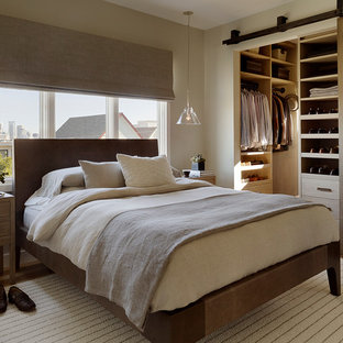 This is an example of a contemporary bedroom in San Francisco with beige walls.