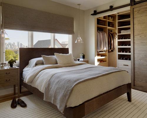 bedroom furniture built in. example of a trendy bedroom design in san francisco with beige walls furniture built