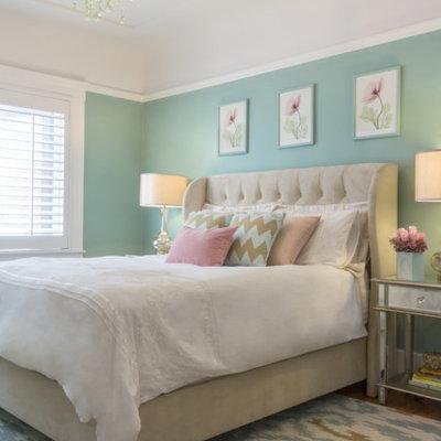 Elegant light wood floor bedroom photo in San Francisco with green walls