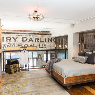 Inspiration for an industrial loft-style bedroom in Vancouver with medium hardwood floors.