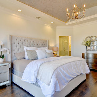 Large transitional master dark wood floor bedroom photo in Dallas with yellow walls