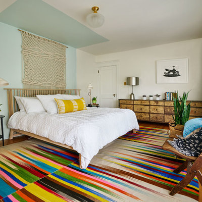 Inspiration for a mid-sized eclectic master medium tone wood floor bedroom remodel in Portland with multicolored walls and no fireplace