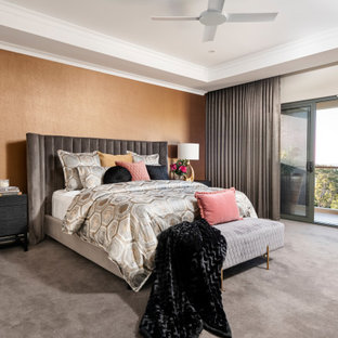 This is an example of an expansive contemporary master bedroom in Perth with orange walls, carpet and grey floor.